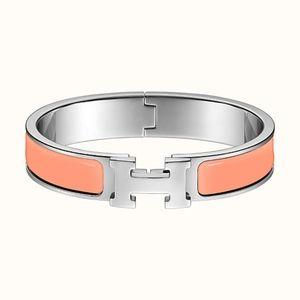 Clic H bracelet in Silver and Orange bangle cuff